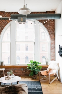 my-paradissi-my-home-my-paradise-colorful-loft-exposed-brick-wall-arched-window-madelynn-furlong-apartment-wing-ta-the-everygirl