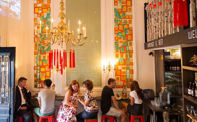 dumplingsbeer-patrons-seated-wall